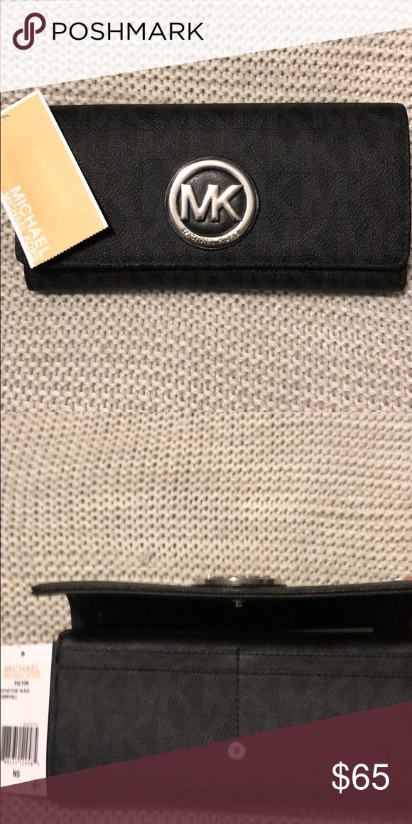 d93d615cd7ce6a Michael Kors Fulton carry-all wallet in black MK signature PVC Snap closure  10 credit