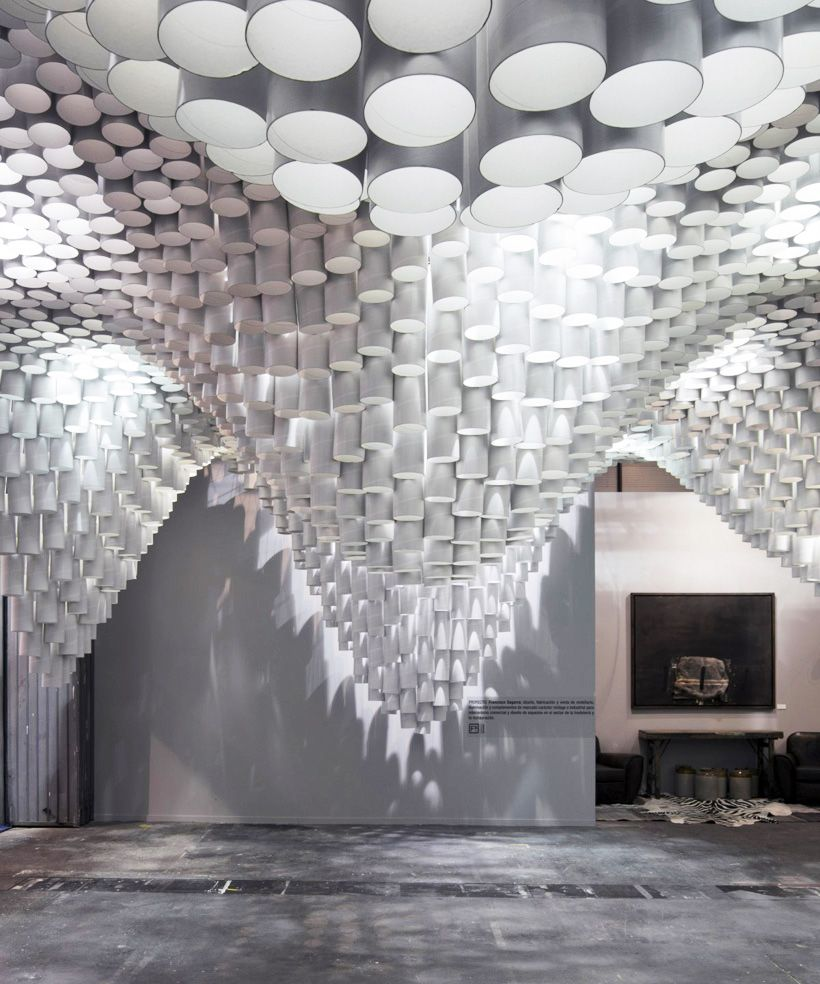 Paper chandeliers by cristina parreño