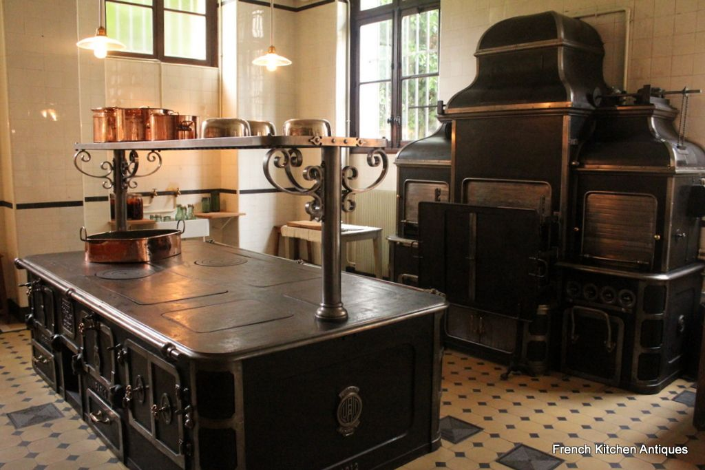 View of the kitchen with the enormous stove and furnace  To