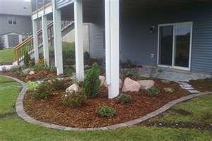 Edge Around The Deck With White Rock Instead Of Mulch Under Deck Landscaping Deck Landscaping Patio Under Decks