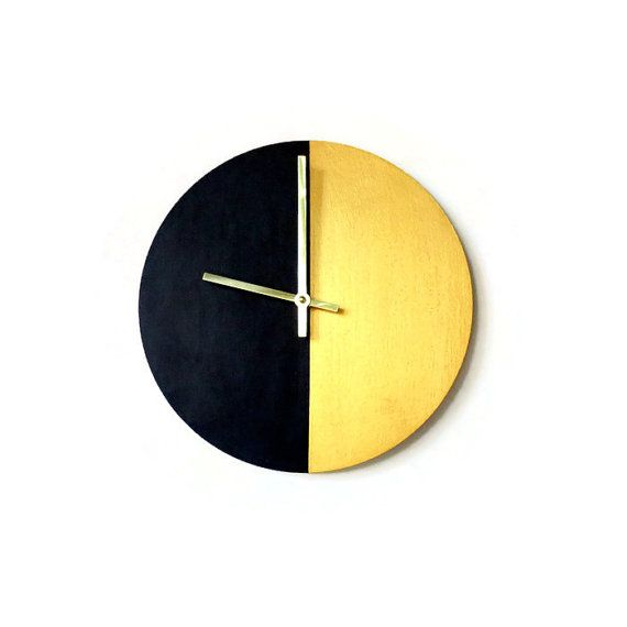 This modern black and gold wall clock is positively glistening with opulence and a measure of allure. Custom handmade from a wood base, it is the perfect harmony of glitz and glamour. The face of this clock features black and gold making it the perfect clock for any room. It will make a sensual addition to your boudoir or anywhere else you want to make a bold statement. Youll fall in love all over again each time you glance at the time. This is a limited edition Shannybeebo design. Order now…