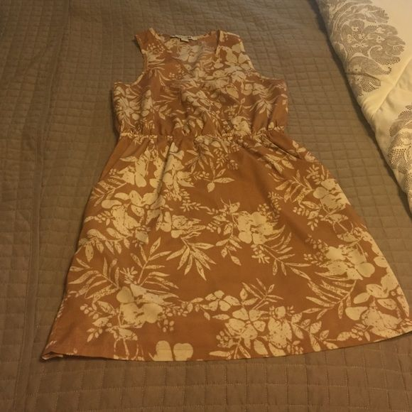 Forever 21 dress This dress is gently loved colors are light pink and beige very cute crisscross is in the front and has pockets Forever 21 Dresses Mini