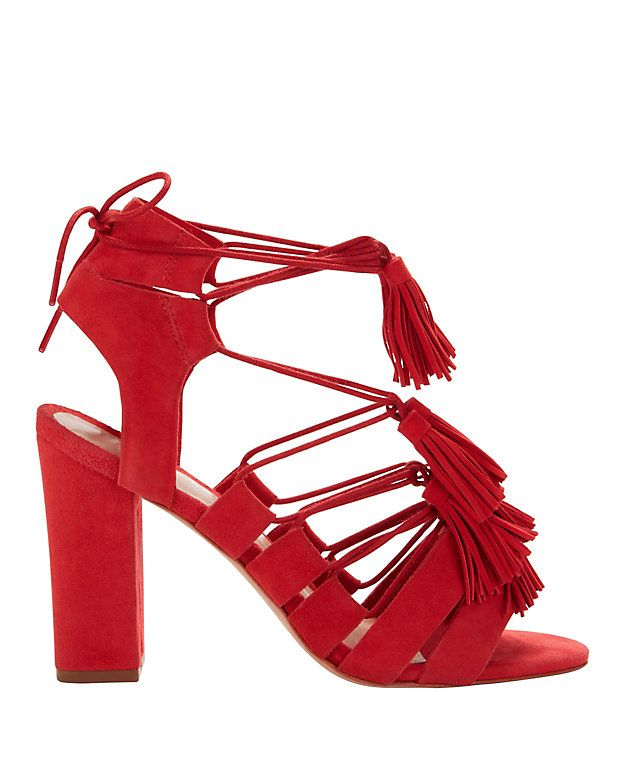 38759ea8efc5 Loeffler Randall Luz Suede Lace-Up Tassel Sandals  A fiery red suede picks  up our step on these chunky heeled sandals. Lace-up tassel detailing at  vamp.