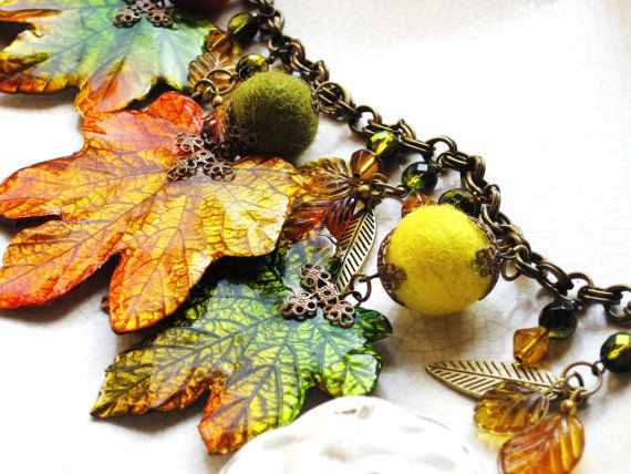 Beautiful fall or autumn colors, ones that you would see on a walk in the park or on a mountain, abound in this gorgeous work of art. Colorful, playful and full of magic, this is a one-of-a-kind design. Preserved and handtinted maple leaves in gorgeous greens, golds, oranges and reds are the focal of this statement piece. Colorful fall color handfelted wool beads with filigree bead caps join the leaves along an antiqued brass double link chain with a lobster claw clasp. Beautiful faceted…