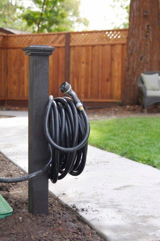 Simple DIY Hose Holder Garden hose storage, Garden hose