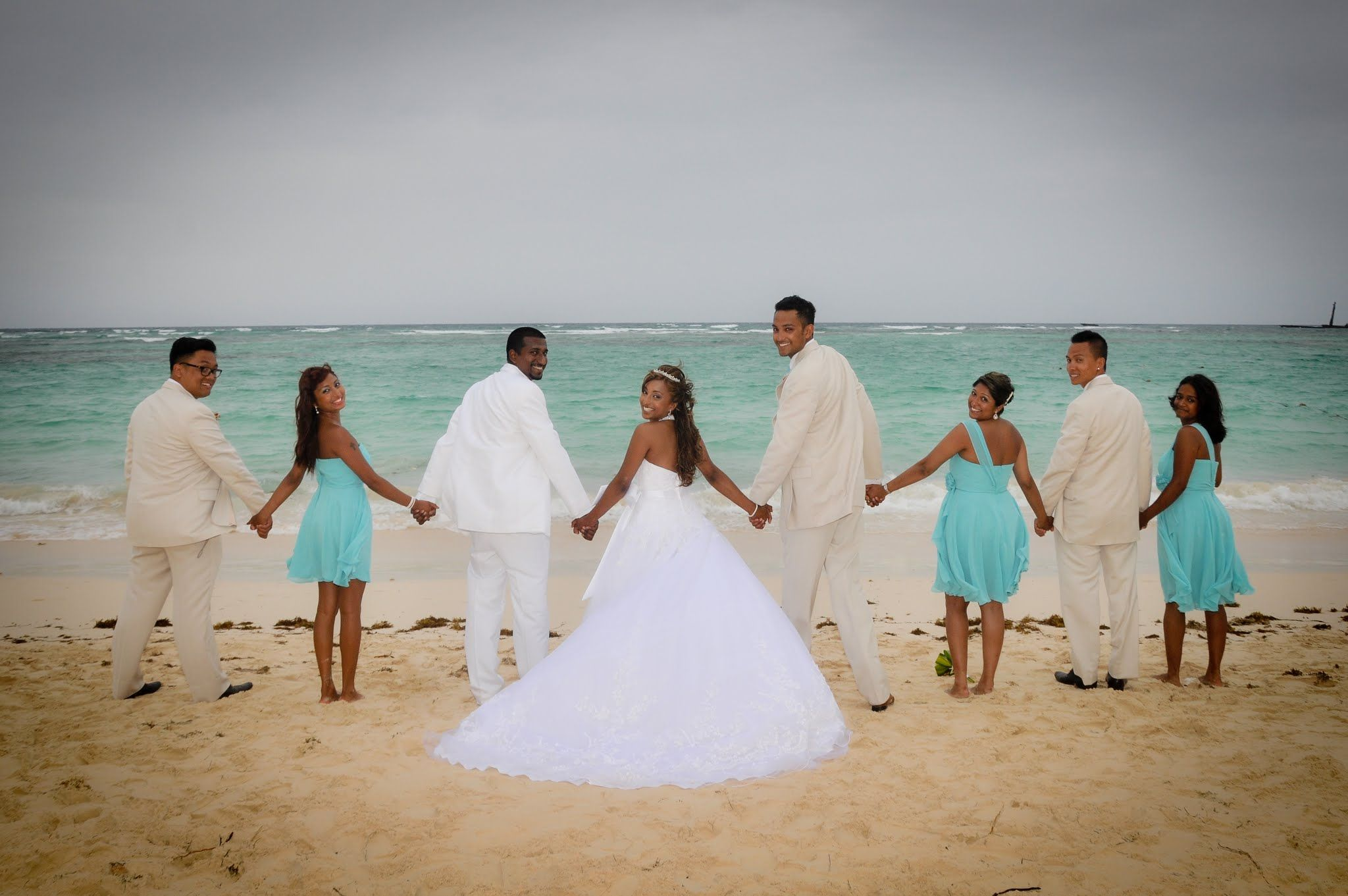 all white wedding dress Bridal Party Beach Side Pictures Destination Wedding Bavaro Punta Cana DR Bride in Casablanca all white wedding gown with a hand beaded veil