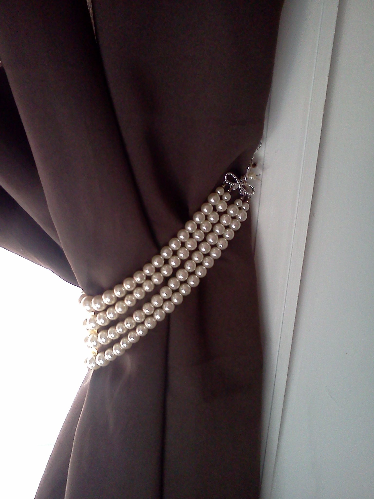 costume vintage jewelery used as curtain tiebacks! thank u anty mothann!