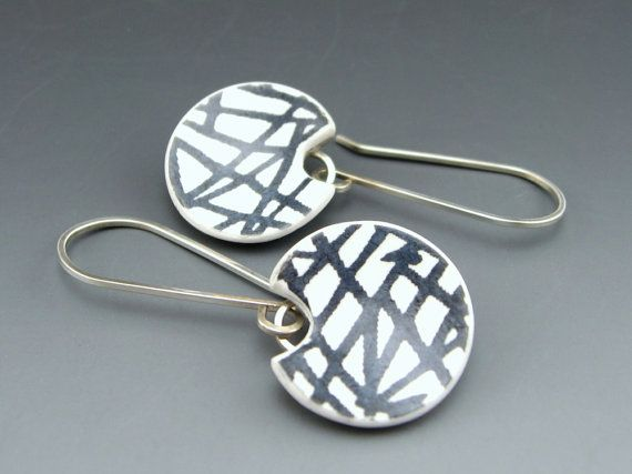 Contemporary black and white polymer earrings with linear design