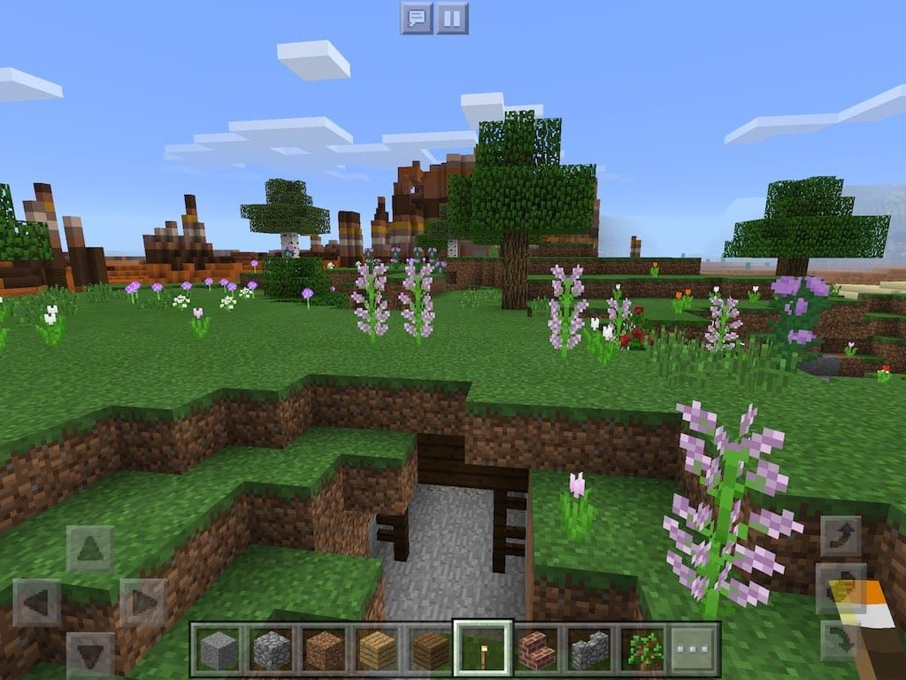 Rails and a mob spawner from a mesa mineshaft have spewed out onto a flower forest biomes floor a beautiful seed