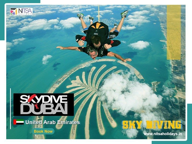 Skydive Dubai Nitsa Holidays Enjoy An Unforgettable T In 2020 Holiday Tours Skydiving International Holidays