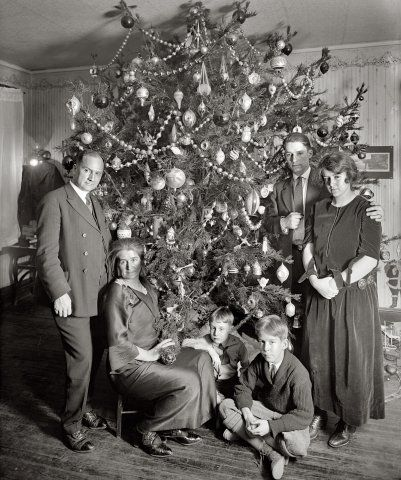 Vintage christmas photograph family gathered by the christmas tree circa 1920s