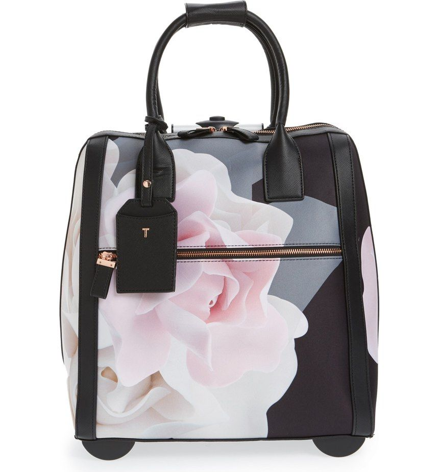 With its lush floral print and gleaming hardware, this travel bag turns any getaway into a stylish event.