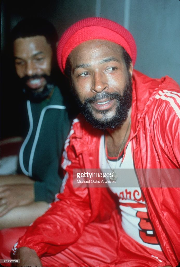 Soul singer Marvin Gaye rests on the bench wearing a red beanie and  basketball uniform during a pick up charity basketball game in circa 1980. a936a431b63