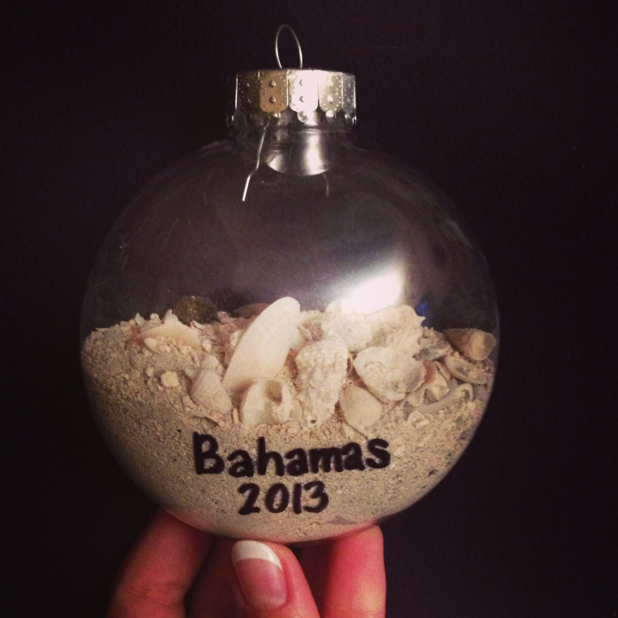 DIY Christmas Ornament Craft Idea - Every year when you hang your ornaments you can remember the amazing vacation you had! Save sand and shells from a vacation during the year and put into an empty ornament (preferably a plastic one, so it won't break and spill sand everywhere)!
