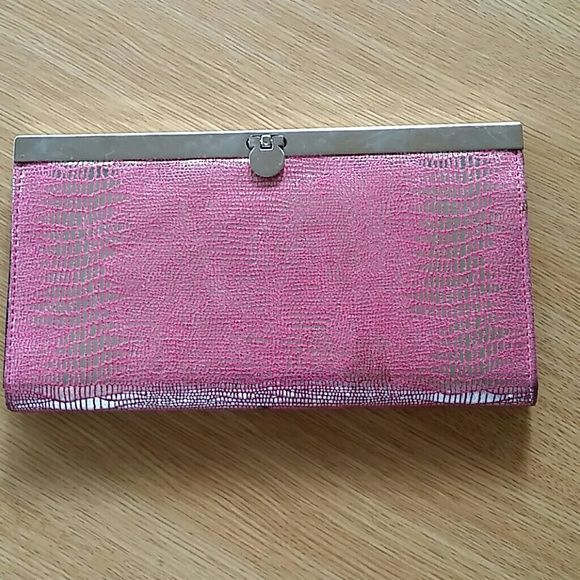 Pink faux snake skin wallet Very delicate material. Silver clasp lock on this trip pocket wallet. Has space for DL and debit card, zippered pocket for change or jewlery, plenty of space for credit and rewards cards. Is gently used, pictures of edge of wallet reflect wear. Bags Wallets
