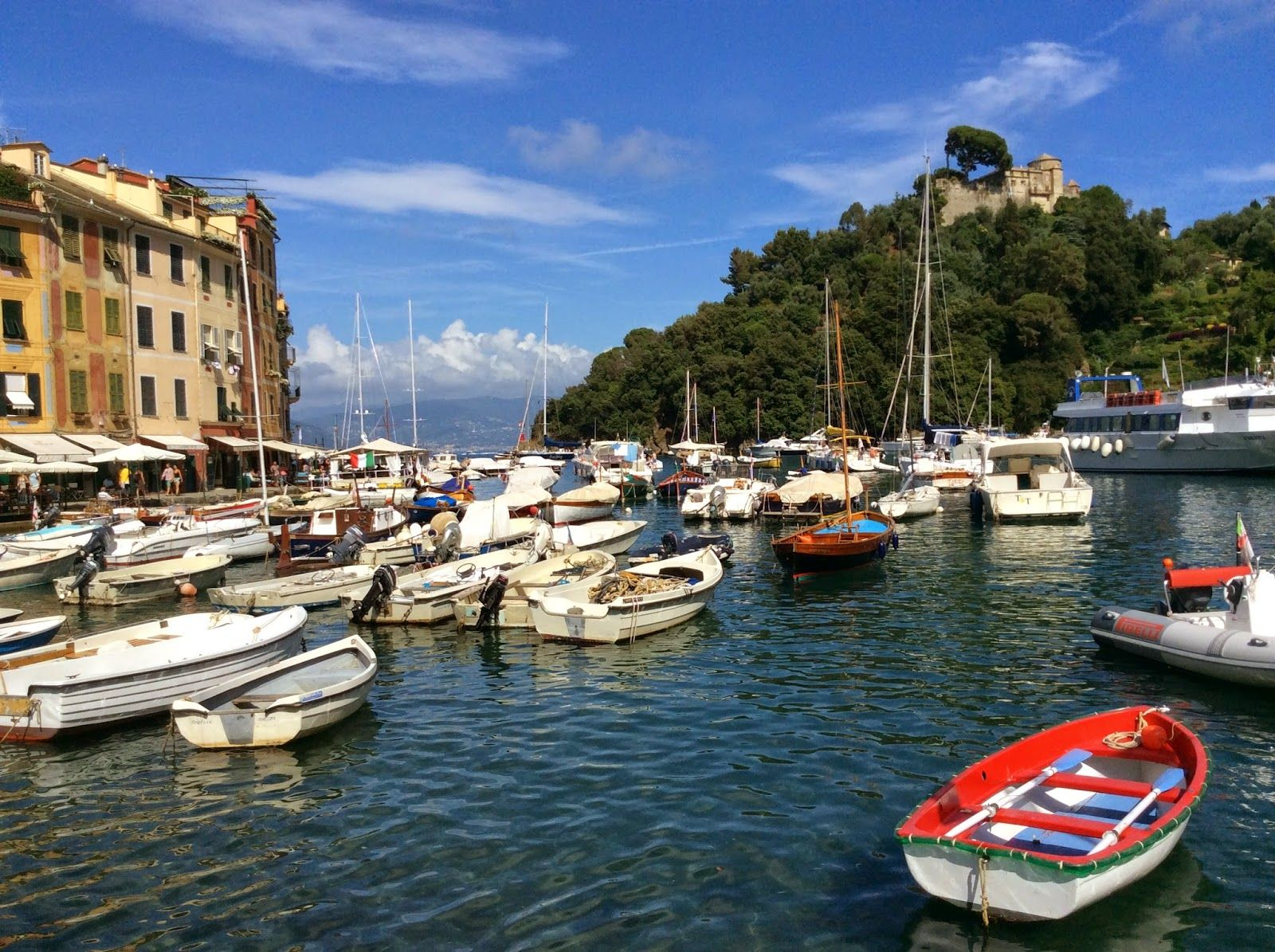PORTOFINO:  The harbour and Castello Brown on the hilltop http://destinationfiction.blogspot.ca/2015/03/resort-towns-of-italian-riviera.html