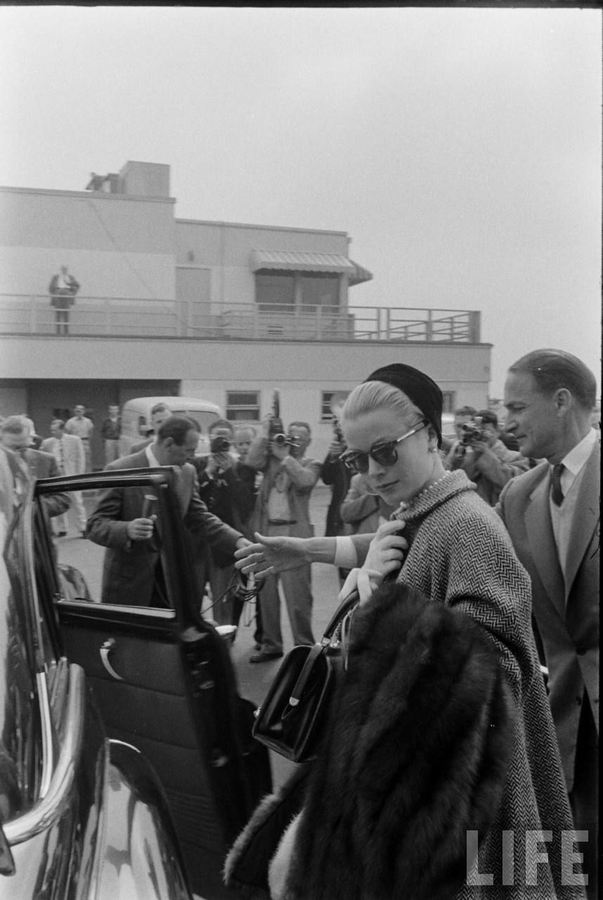 Grace Kelly's Departure From Hollywood. Date: March 1956. Photographer: Allan Grant.