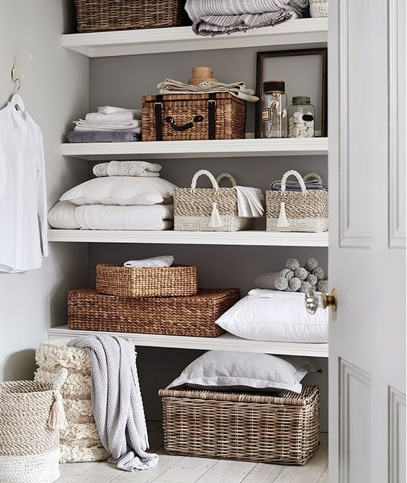 Storage Baskets And Storage Boxes On Open Shelves Baskets For