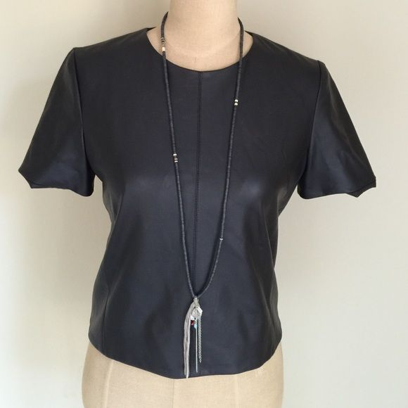Faux leather zip back top Super cute!  Love the zip back detail. Add a little edge to your outfit day or night!  95% polyester 5% polyurethane  lining 100% polyester  fully lined. Very soft and supple! Maginn Tops