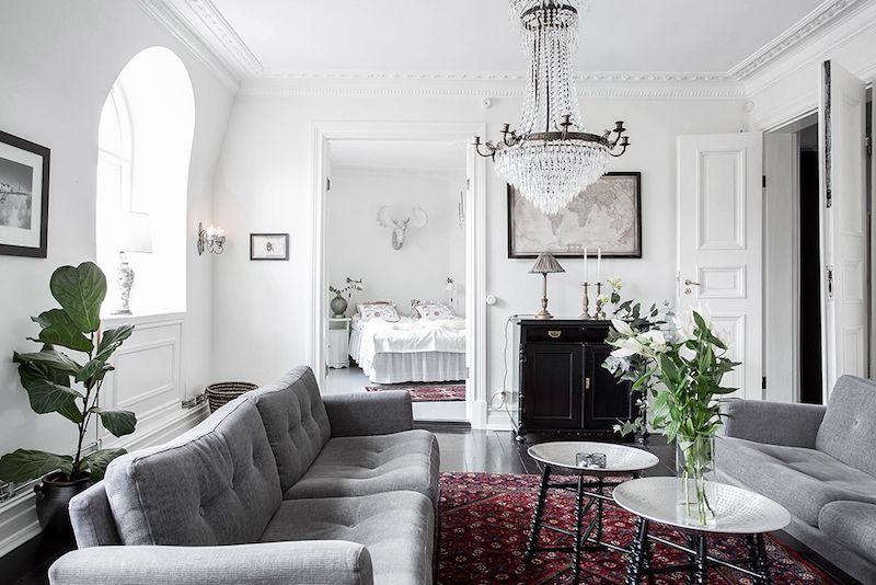 Scandinavian home design combining white, black and original decor