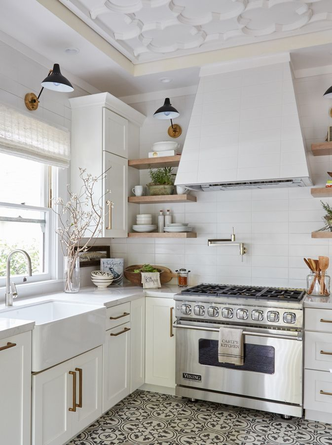 All-white kitchen with brass hardware and gray and white mosaic tile ...