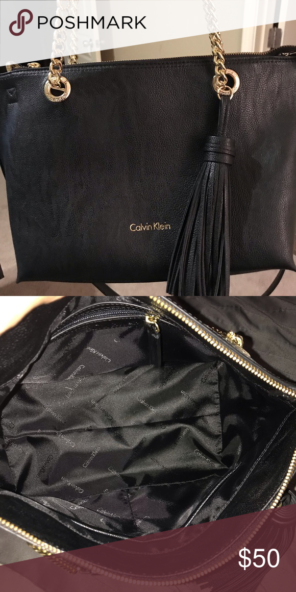 b82fbd0b0c9 Calvin Klein purse Black shoulder purse with gold link straps and one large  black tassel. Shoulder strap also included. Never used. Calvin Klein Bags  ...