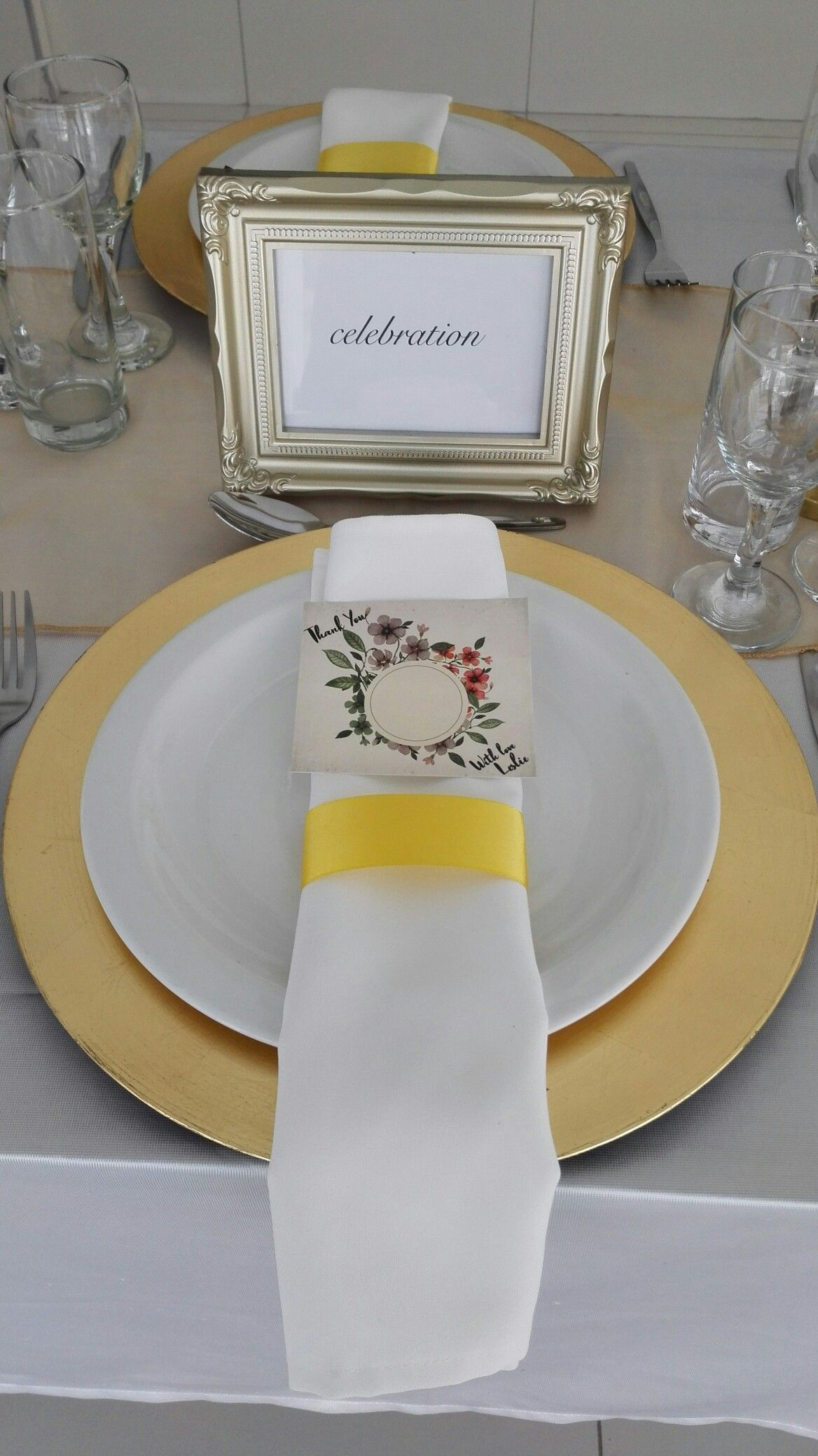 White, gold and greenery. Gold charger plate. White napkin. elegant ...