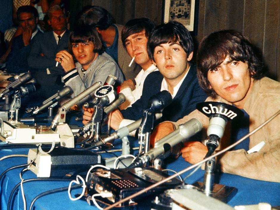 The Beatles handle press conference in the Hot Stove Lounge before their two shows at Maple Leaf Gardens on August 17, 1965 CREDIT: John Rowlands