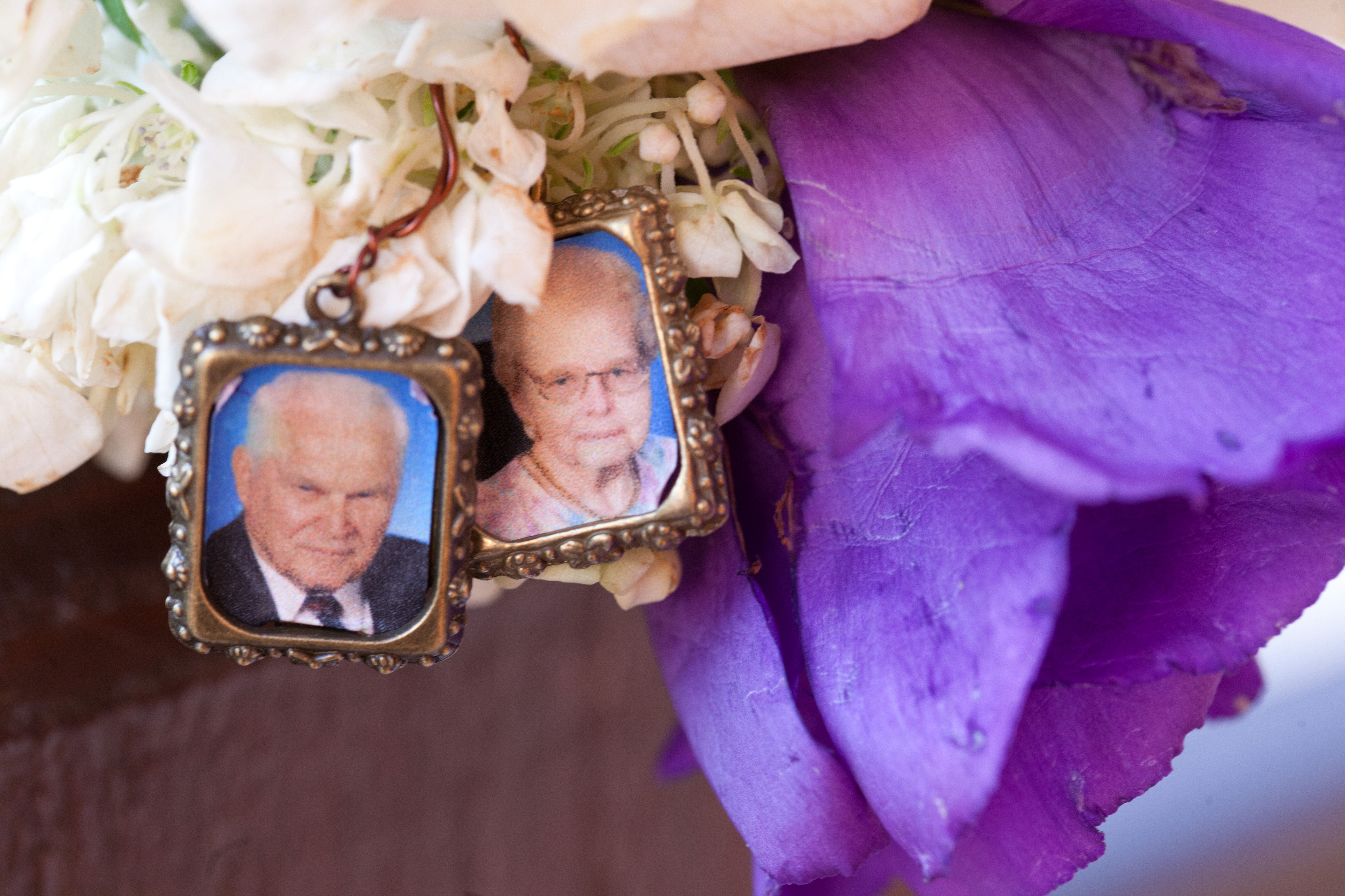 this bride had little pictures of loved ones that have passed away tied to her bouquet!  so cute! #MinneapolisWeddingPhotographers