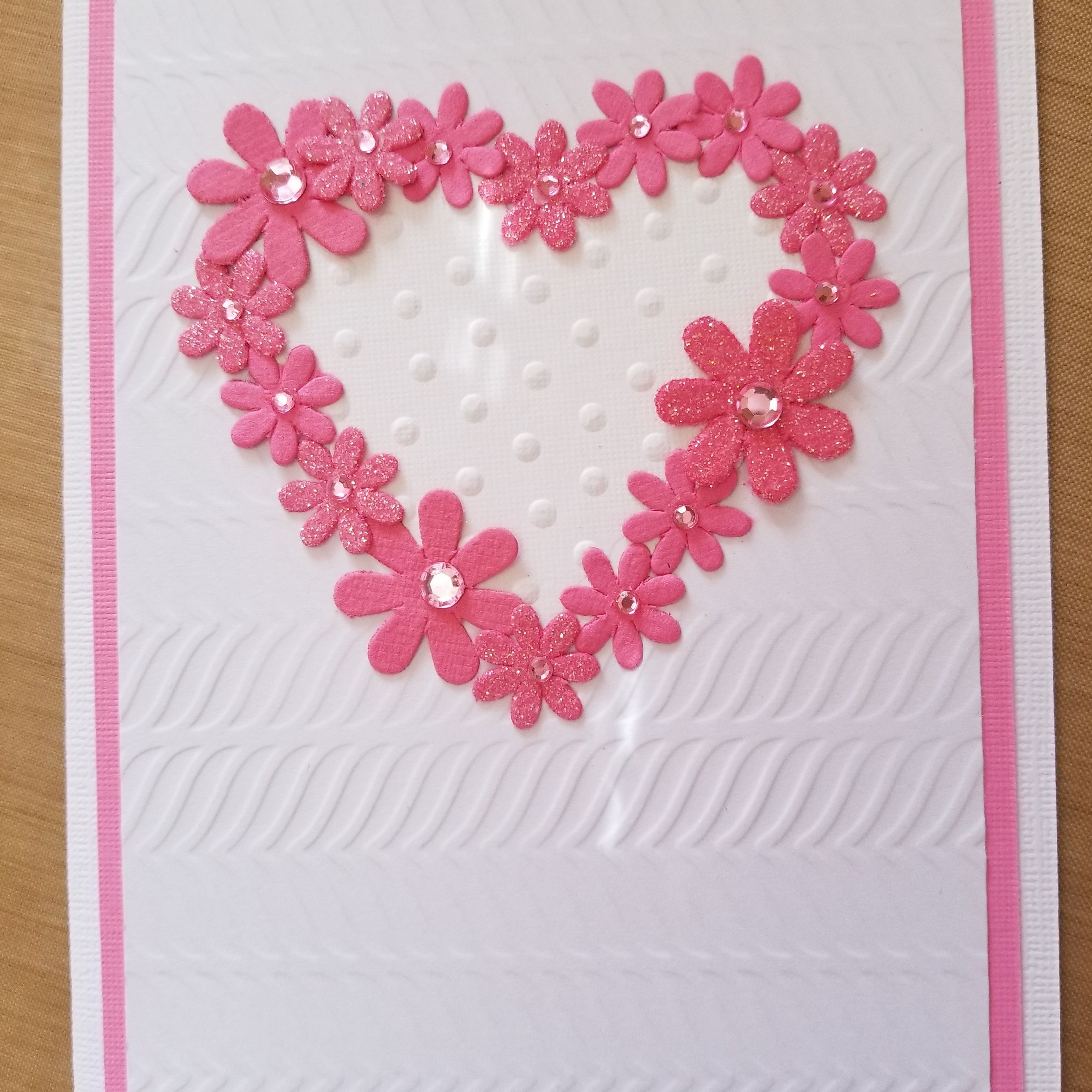 Valentine With Flowers In Heart Shape Embossed Background