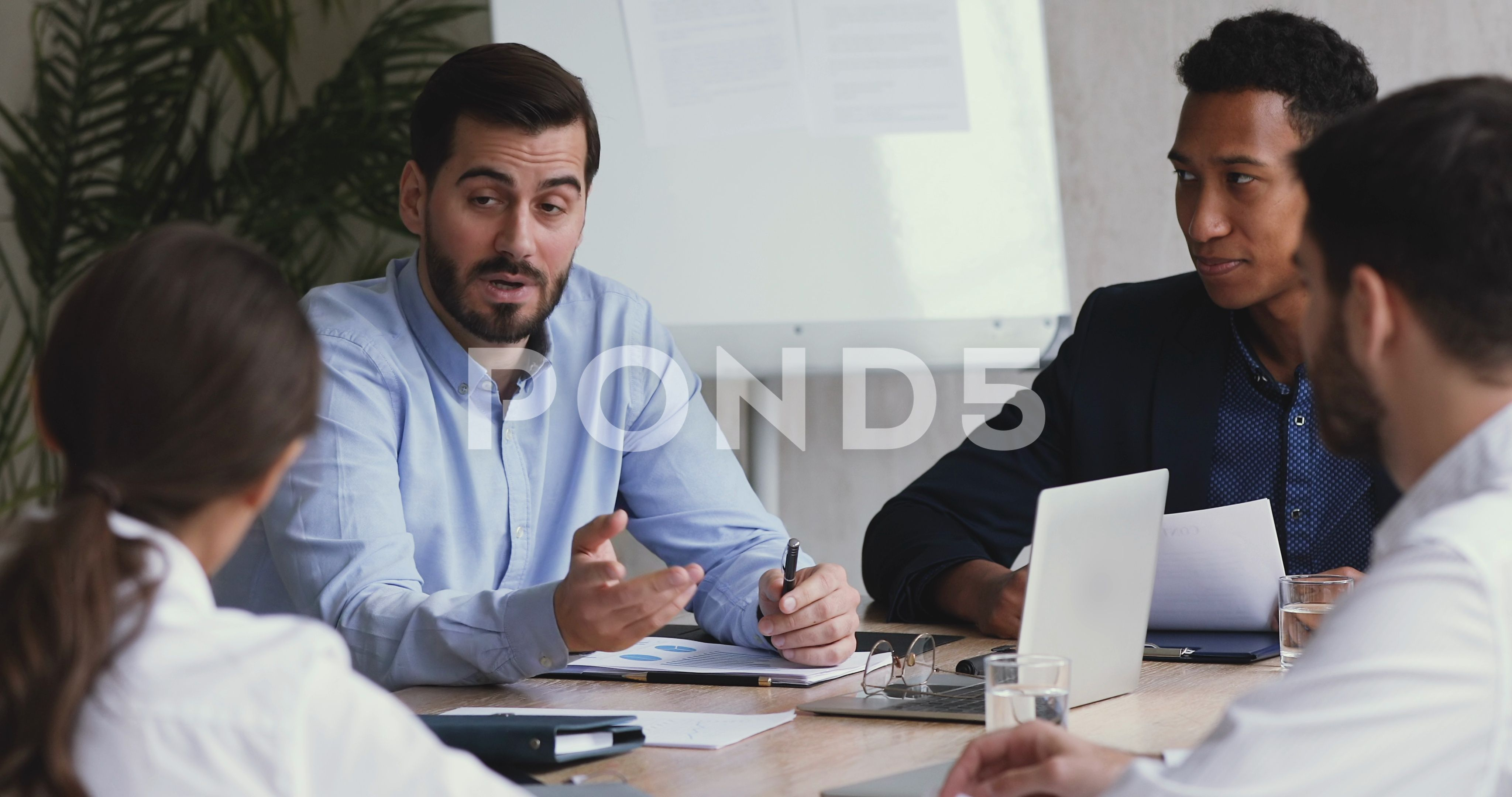 Boss speak to diverse employees explain corporate strategy at briefing Stock Footage employeesexplaindiverseBoss