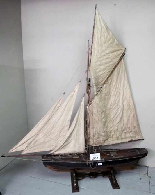 A large 19c wooden pond yacht complete with sails and rigging