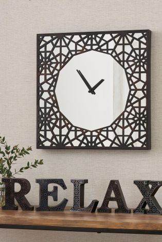 living room clocks next ideas with dark brown furniture metal cutwork and mirror wall clock from home