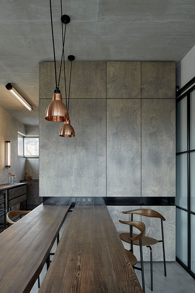 The architect kept the structure's naked concrete ceilings, walls and floors