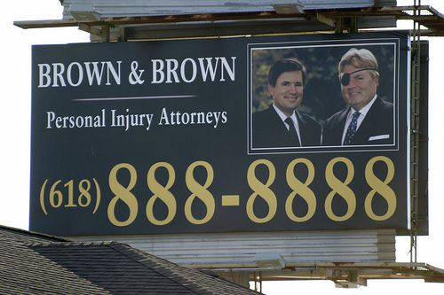 The first time I saw this billboard I couldn't believe it was real. I'm still not sure if I believe this is real. A combination of the eye patch and that phone number strikes me as incredibly funny.   Funny - Hilarious Signs & Billboards