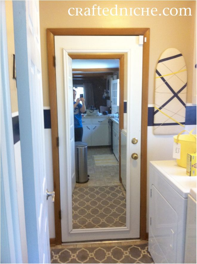 laundry room makeover love the mirror added to old door for an easy rh pinterest com