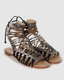 1c24edbd336 Sandalias planas de mujer Schutz de piel con estampado animal · Schutz ·  Moda · El Corte Inglés