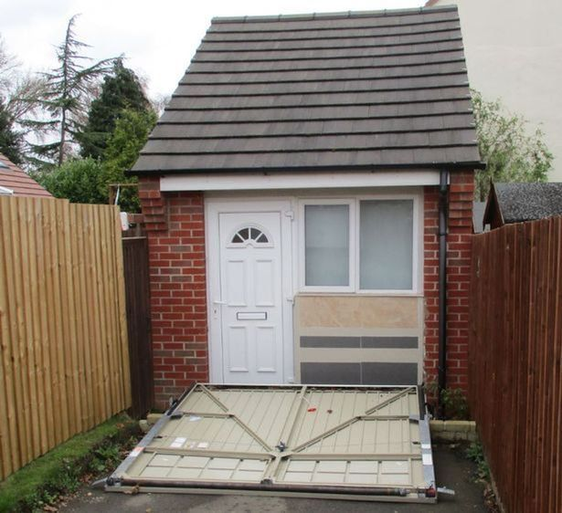 Couple fined for using a fake garage door to disguise a