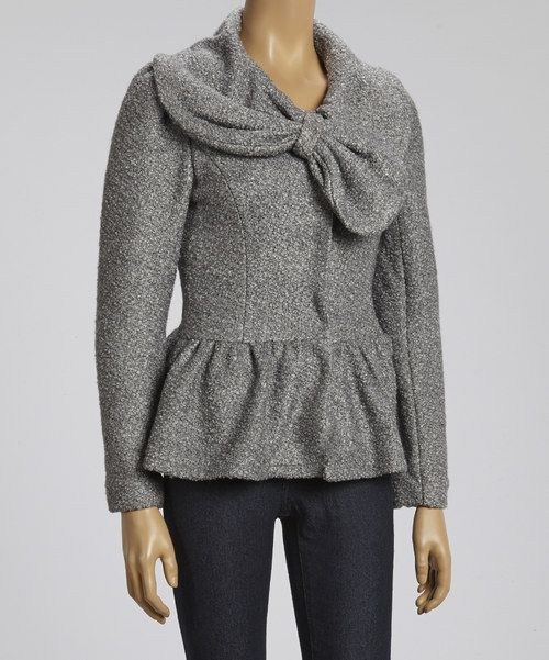 When the weather takes a chilly turn, stock up on classics like this jacket. Featuring a pert ruffled peplum and long sleeves, it brings a distinctive look to a blustery day's ensemble, while a sumptuous wool blend keeps it warm.Measurements (size S): 24'' long from high point of shoulder to hem60% polyester / 40% woolDry cleanImported