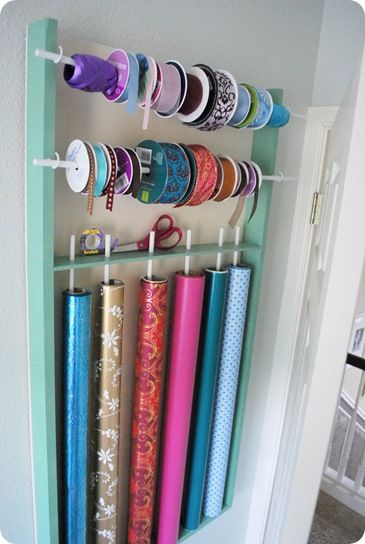 DIY ribbon and wrapping paper storage. Really wish I had this ...