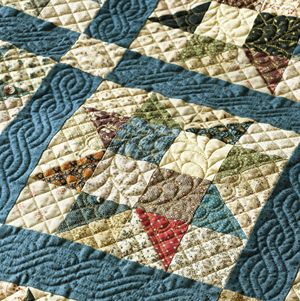Love the quilting on this one!!  Wow!  Feather Quilting Designs ~ Star Formation