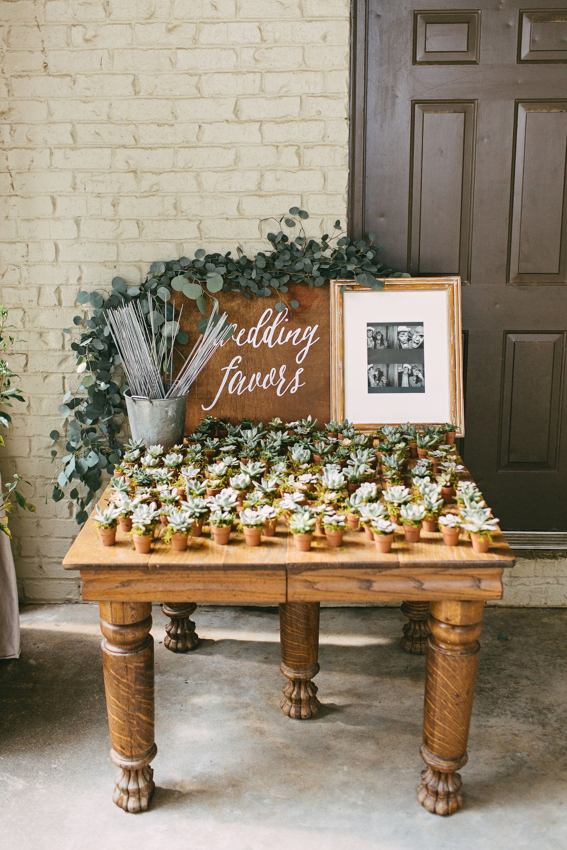 Wooden table, wedding favors stand, mini potted succulents