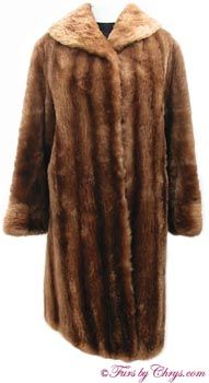 Vintage Sheared Raccoon Fur Coat SR408; Now $200 (was $275); Approx. size range: 8 - 12 Average or Petite; Good condition. This is a beautiful vintage genuine dyed sheared raccoon fur coat. It features a shawl collar and has elasticized lining at the sleeve ends to keep the cold out. There are two exterior pockets and a zippered pocket hidden in the lining. The lining is solid brown and there is NO MONOGRAM. It closes with furrier's locking clasps. You will be nice and warm!