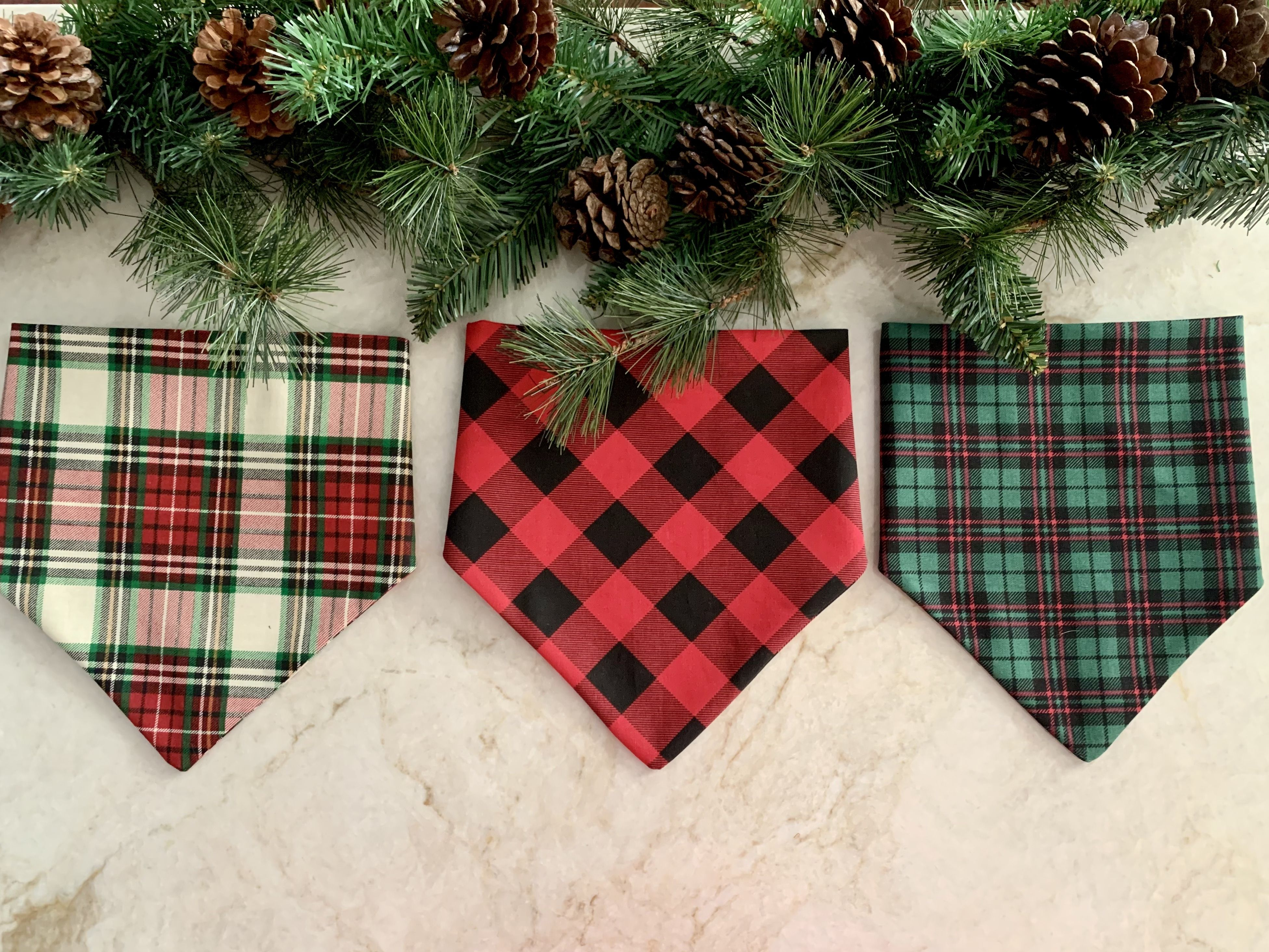 Christmas plaid dog bandanas, slip on right over the collar. Red and black buffalo plaid, christmas plaid, and green plaid. Get your dog ready for the holiday season with these bandanas! #sitstaybay #dogbandanas #bandanasfordogs #christmasplaid #buffaloplaid #buffalocheck #christmasdog #christmasbandanas #dogbandana #etsyfordogs #redandgreenplaid #giftsfordogs #dogsmusthave #christmasgifts #dogsfirstchrismas #dogaccessories