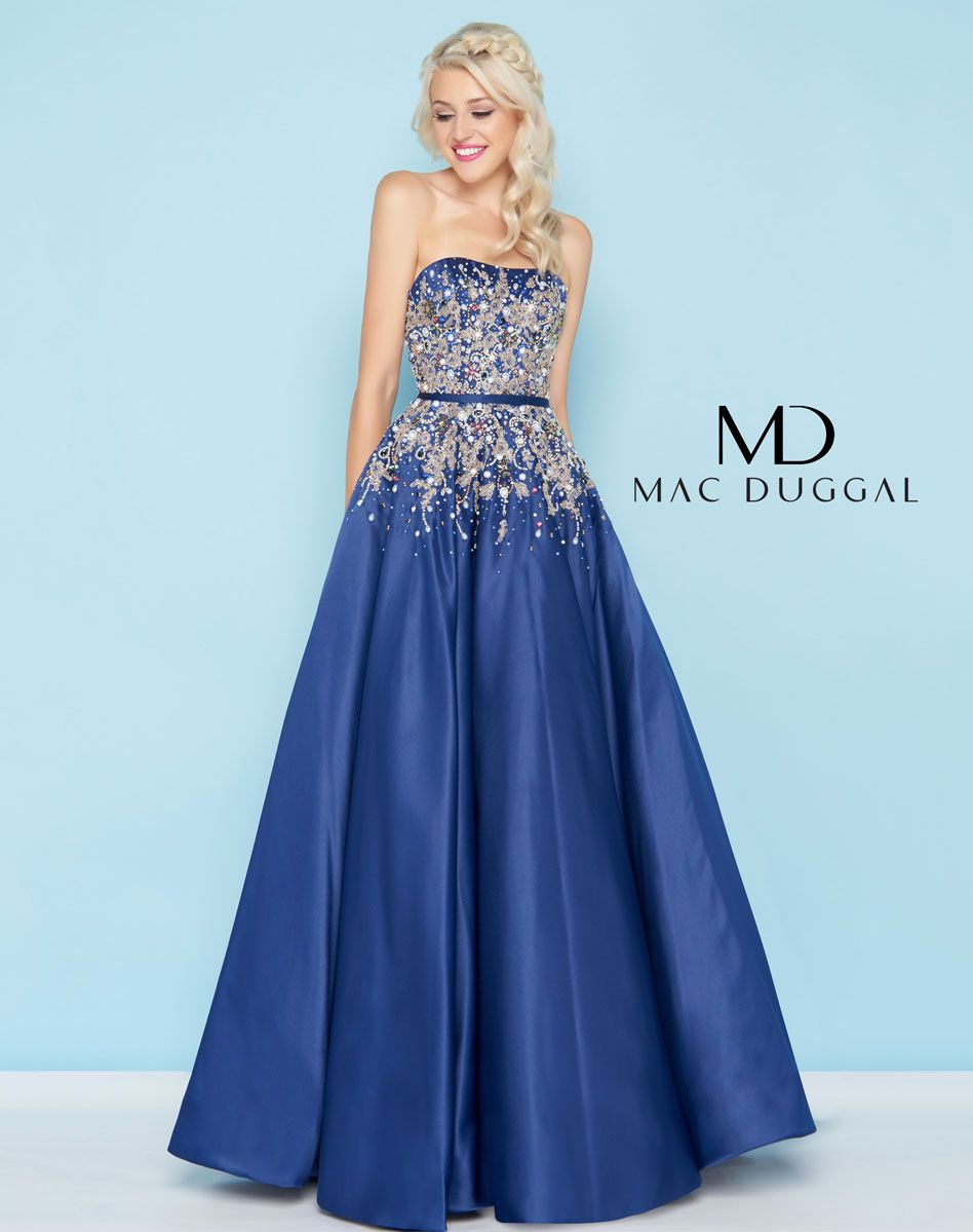 6113b7956c702 Make a statement in this heavily adorned satin ball gown. Jeweled crystals  and pearls intertwined with gold threadwork cover the bodice.