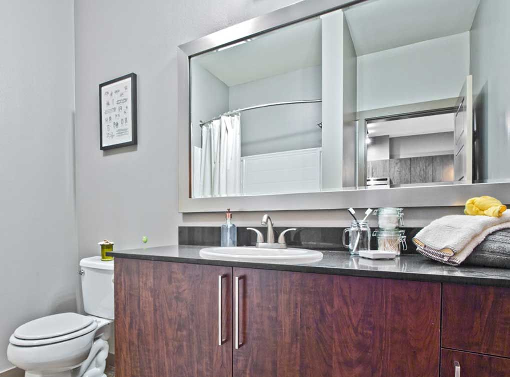 Model Bathroom Featuring Elegant Quartz Countertops At AMLI Mark24, Seattle  Apartment Rentals.