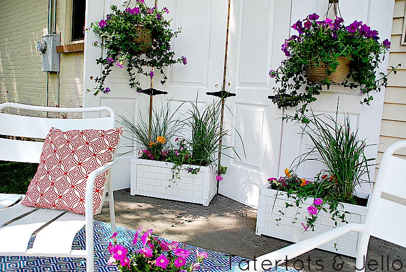 Turn old doors into an outdoor privacy screen, via Tater Tots and Jello