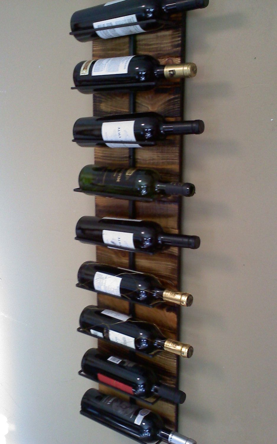 Wall Hanging Wine Rack For 9 Via Etsy