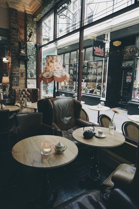 Seating Mismatched Chairs And Round Tables Cozy Coffee Shop