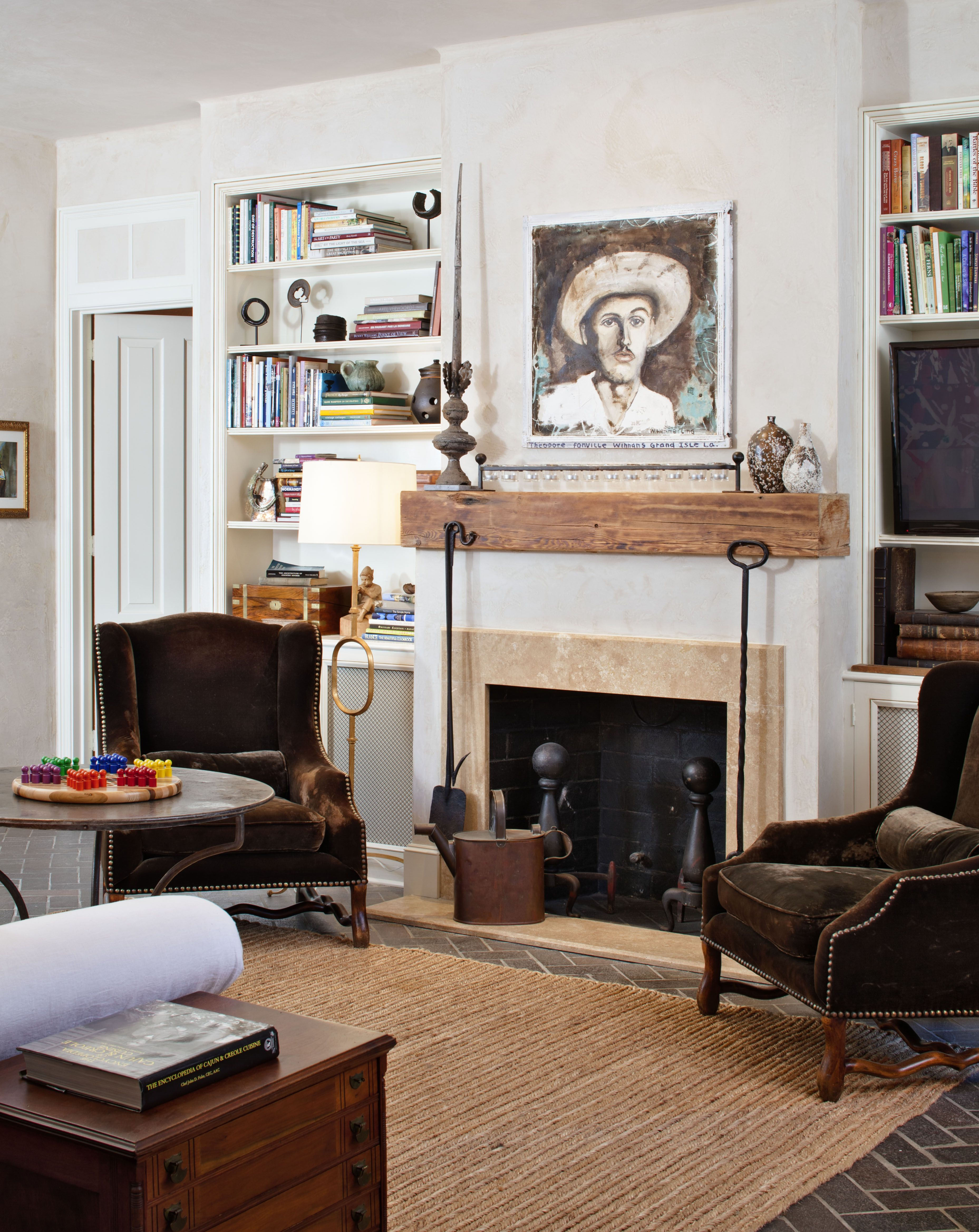 Rustic wood fireplace mantel in this traditional French Quarter living room  | New Orleans French Quarter